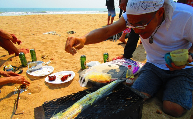 お魚に塩振り坂本さんの写真。